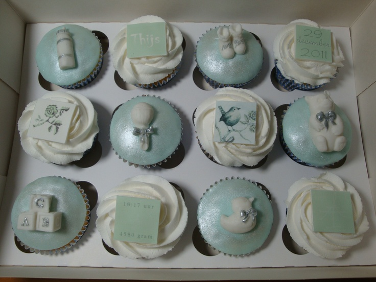 Cupcakes I made for the birth of a boy with several pieces of the birthcard printed on frosty sheets