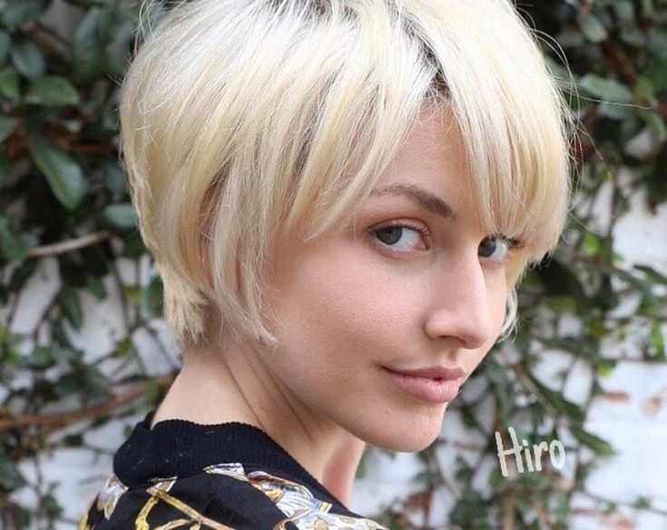 Women's Layered Platinum Blonde Pixie with Messy Textured Fringe and Side Swept Bangs Short Summer Hairstyle