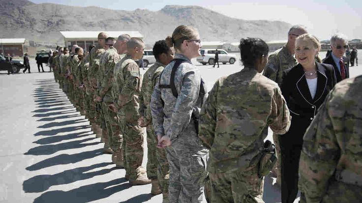 Hillary Clinton, then secretary of state, greets troops in Kabul, Afghanistan, in 2012. She logged nearly a million miles visiting 112 countries in that position.