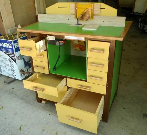 Tilting router lift and the router table.