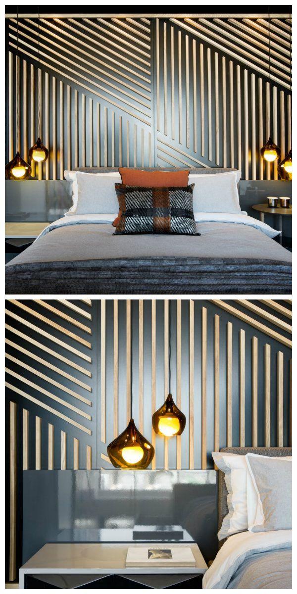 Очень интересные светильники были использованы в этой спальне. Теплый приглушенный свет разливается по комнате от четырех изящных ламп.  Особый акцент - это оригинальная стена позади кровати. Великолепное сочетание четких линий и округлых форм светильников создают замечательное настроение и ощущение комфорта. Такое впечатление, что ты находишься внутри картины известного художника и являешься частью произведения искусства мирового значения.