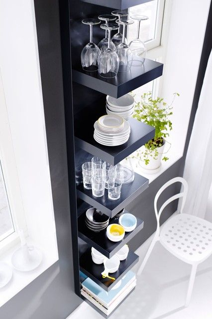 Get creative with storage solutions - they don't have to be used for the purpose for which they were designed. Here, an Ikea bookcase is used to display crockery and glassware in the kitchen.