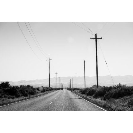 Electric poles on both sides of a road Bakersfield Kern County California USA Canvas Art - Panoramic Images (18 x 24)