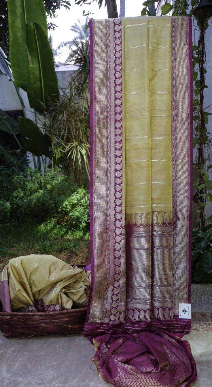 This Benares tussar is in biscotti tan with gold zari work. The complementing border and pallu are in dark violet intricately woven with gold zari making it look elegantly beautiful.