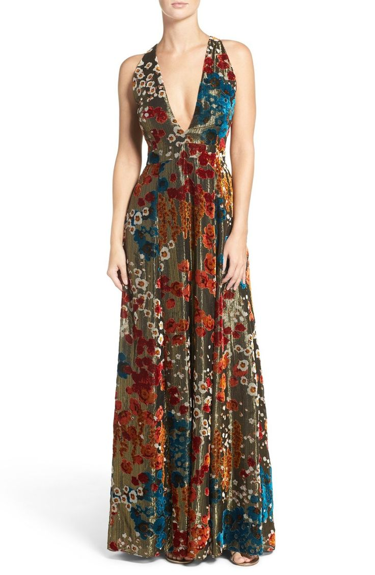 This long, fluid evening gown is rich in texture and dimension with metallic threads and soft burnout velvet saturated in jewel tones.