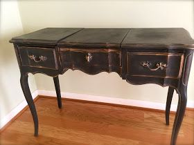Here's an easy way to update a piece of furniture! Cute little french provincial vanity… all frou frou and curvy… just boring. ...