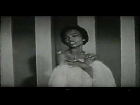 A video of Eartha Kitt doing Santa baby with three friends helping her out :o))