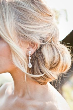 low, loose chignon #wedding