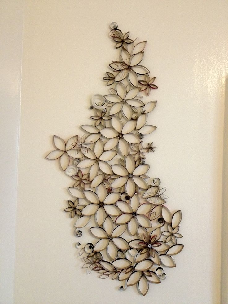 Wall art made from upcycled toilet paper rolls. Pretty