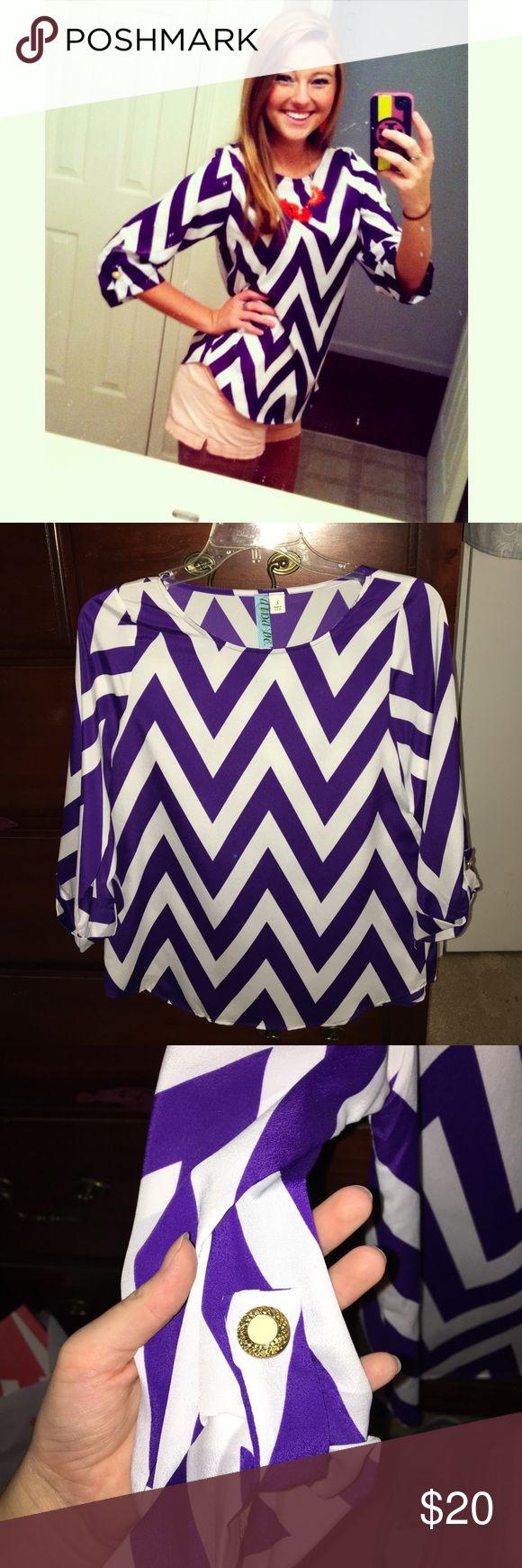 Purple chevron blouse 💜 Worn with the salmon colored shorts I am selling to a Clemson game and got A LOT of compliments! Very cool material and not hot at all. Super comfortable and cute Francesca's Collections Tops Blouses