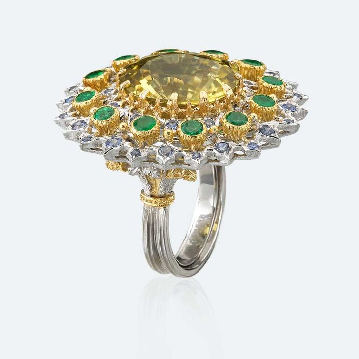 Cocktail ring in white and yellow gold with pale amber tourmaline surrounded by emeralds and sapphires. The tourmaline is the rarest gem dazzling like a rainbow for its amazing multiplicity of colours. In its yellow shades in particular, the tourmaline is able to instil us with the positive energy that gives strength and fosters prosperity and abundance. Http://www.facebook.com/diamonddreamfinejewelers http://www.twitter.com/diamond_dream_ http://www.instagram.com/diamonddreamjewelers