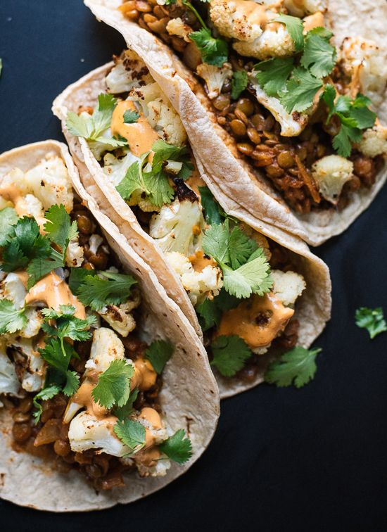 Roasted cauliflower, seasoned lentils and creamy chipotle sauce combine to create an unexpectedly delicious taco. by cookieandkate #Taco #Cauliflower #Lentil #Healthy