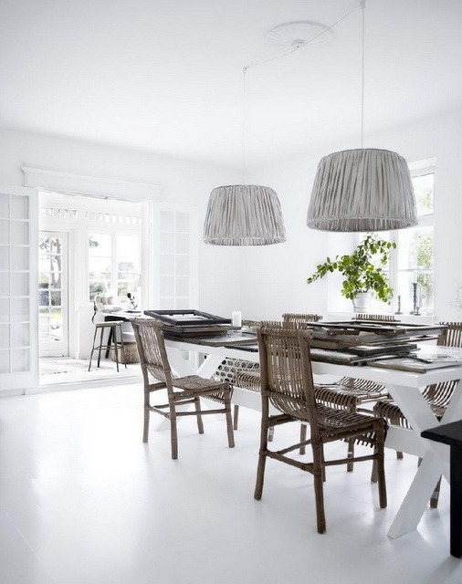 Stunning lampshades from Tine K Home. White floors. dining space.