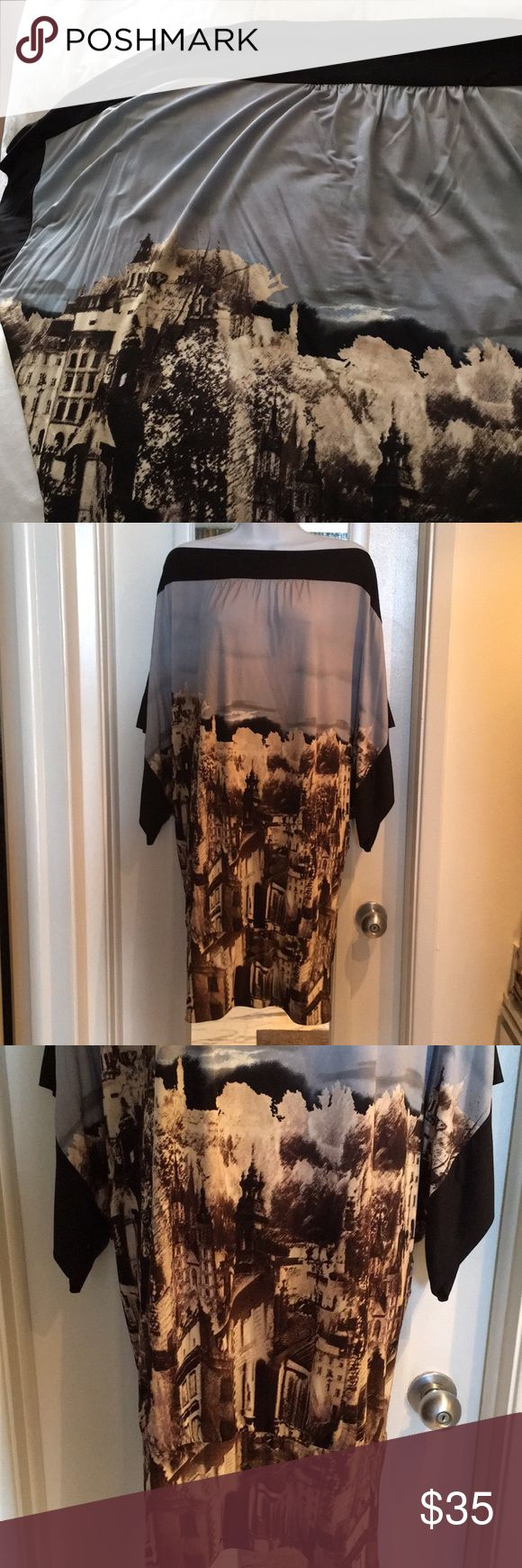 """BCBG MaxAzria szM dress ❤️Beautiful European City print dress. Perfect for an everyday ocasión. I am 5,5"""" and is above my knees. The color of the sky is blue- grey.   In excellent used condition, no stains rips or holes.    Please ask all questions before purchasing to make sure and clear this is what you want. Please don't forget to follow share and like BCBGMaxAzria Dresses Midi"""