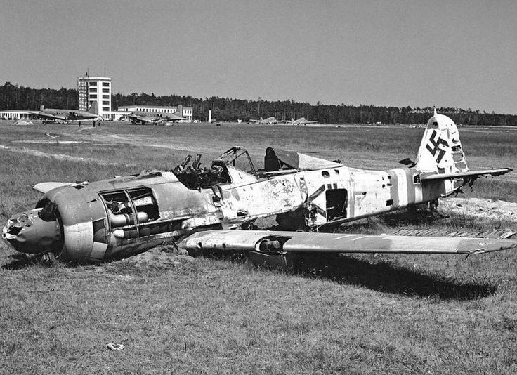 "Focke-Wulf Fw190 D-9 post war at Rhein-Main airfield, Frankfurt in 1945/46. The markings identify the aircraft as a Stab (staff flight) aircraft of JG4.  It bears Defence of the Reich stripes. US transport aircraft in background. See also ""Gotterdammerung Vol 1"" p52-56"