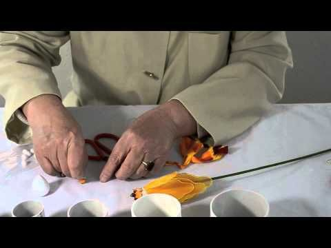 This video will show you how to make the Goldfish, one of the most popular nylon flowers.