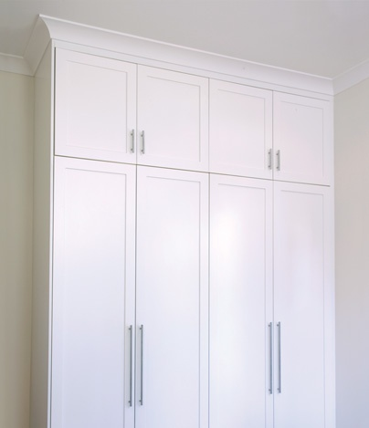 handles for the wardrobe and linen press - long below, shorter above
