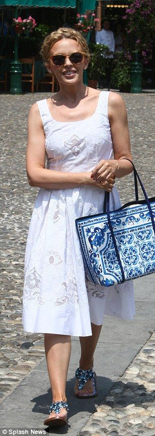 Coordinating ensemble: The Spinning Around hit-maker matched her pretty blue handbag to he...