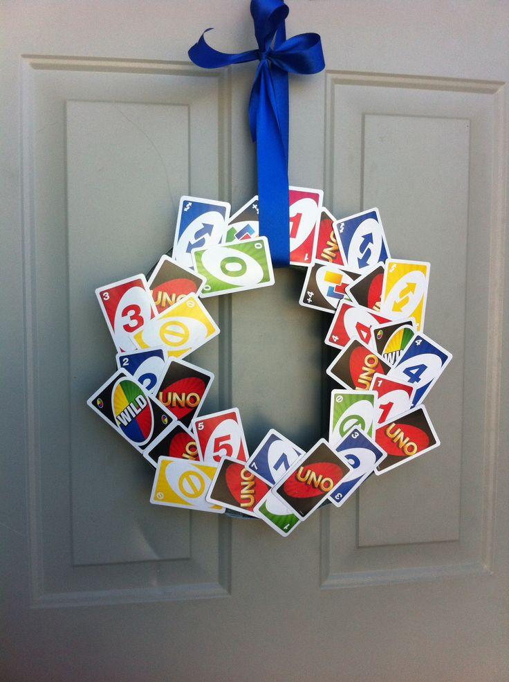 Awesome UNO Wreath on the front door. Made by Megan Gillies and her mother. Just need UNO cards, hot glue gun, ribbon, a styrofoam wreath from Hobby Lobby, and creativity!