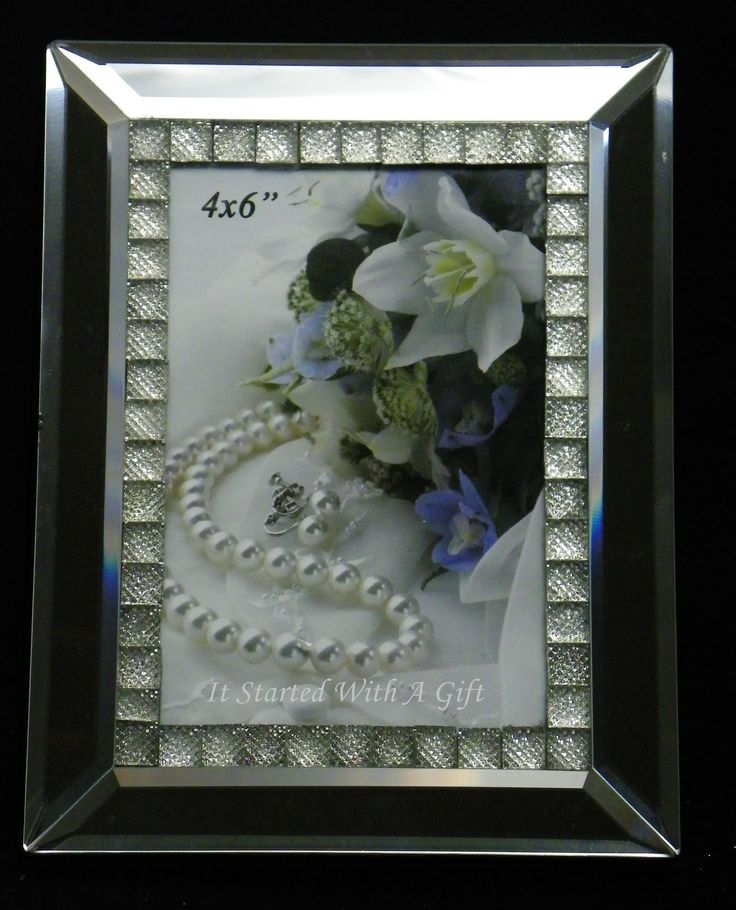 Mirrored Photo Frame With Crystal Inserts 4 x 6 AU$15.00  Share those special moments with this modern photo frame. It's perfect for letting your picture do the talking. A great addition to any home or office, the photo frame is a fabulous easy gift idea.Fea...