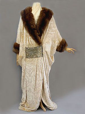 1910 Russian-style cut velvet evening coat with beaded passementerie panels and sable trim.