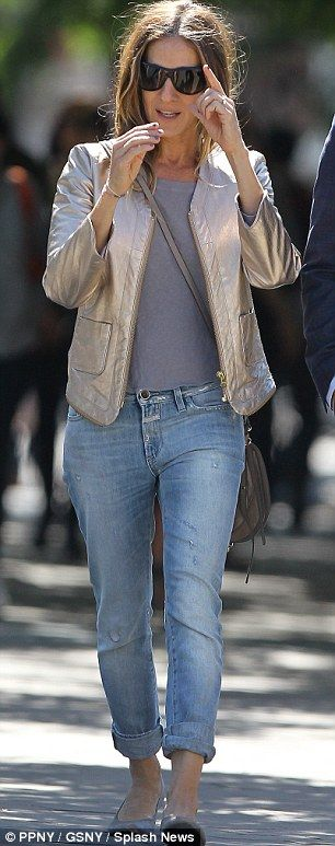 Sarah Jessica Parker looking more like her old stylish self just a day later in a chic gold jacket, grey T-shirt, jeans and grey ballet pumps.