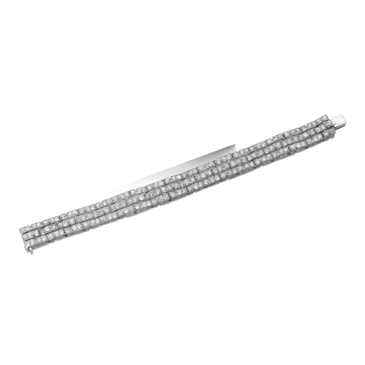 Diamond bracelet, CartierThe articulated band set with circular-, single-cut and rose diamonds, length approximately 185mm, signed Cartier, French assay and partial maker's marks.