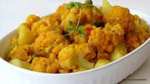 23)Aloo Gobi is a dry Pakistani, Indian and Nepali dish made of potatoes, cauliflower and indian spices. Its yellowish in colour, due to the use of turmeric and occasionally contains kalongi and curry leaves.