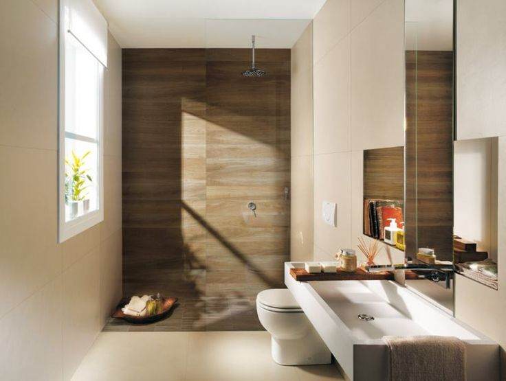 warm looking brown backdrop in the shower gives beautiful wood paneling effect