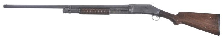 Winchester M1897 shotgun    Designed by John Browning, manufactured by Winchester Repeating Arms c.1897-1957 - serial number E602975.  12 gauge 5-round tubular magazine, pump action repeater, full-length 30″ barrel.