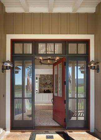 love the color of the siding and trim - and the dark windows and the fun red door!