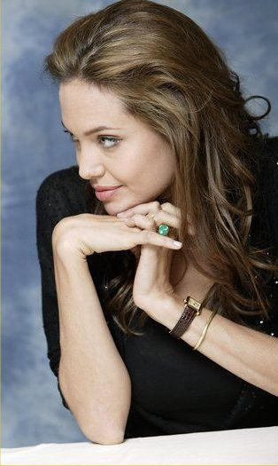 Angelina Jolie in Cartier Tank - $6,000...At Oaks Pawn we recently had the solid 18kt white gold Cartier Tank!!!