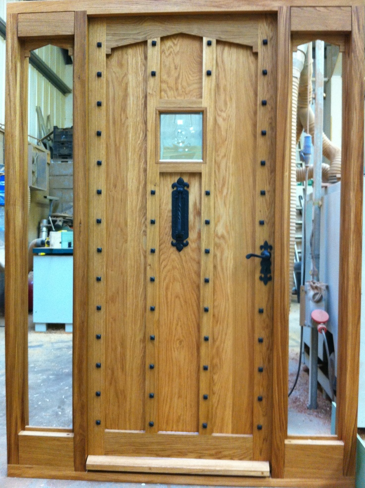 Gorgeous oak door and side panels with black antique style ironmongery and black stud detail. For the studs and ironmongery click below: http://www.priorsrec.co.uk/door-furniture/nails--studs/c-p-0-0-3-58