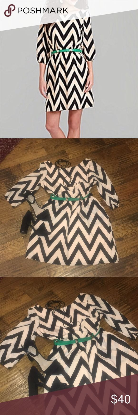 Gianna Bini Chevron Print Dress Size-Large Gianni Bini Chevron Print Dress with three quarter length sleeves.  Dress has an elastic waist and side pockets on the skirt.  Green belt is included.  Dress is in very good condition.  Size -Large Gianni Bini Dresses