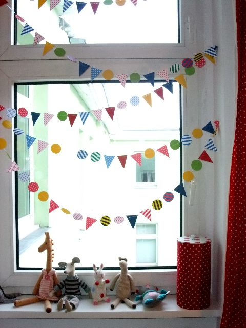 I adore tiny bunting. A beautiful way to light up a room. You could use transparent paper to let the natural light project colours into the room.