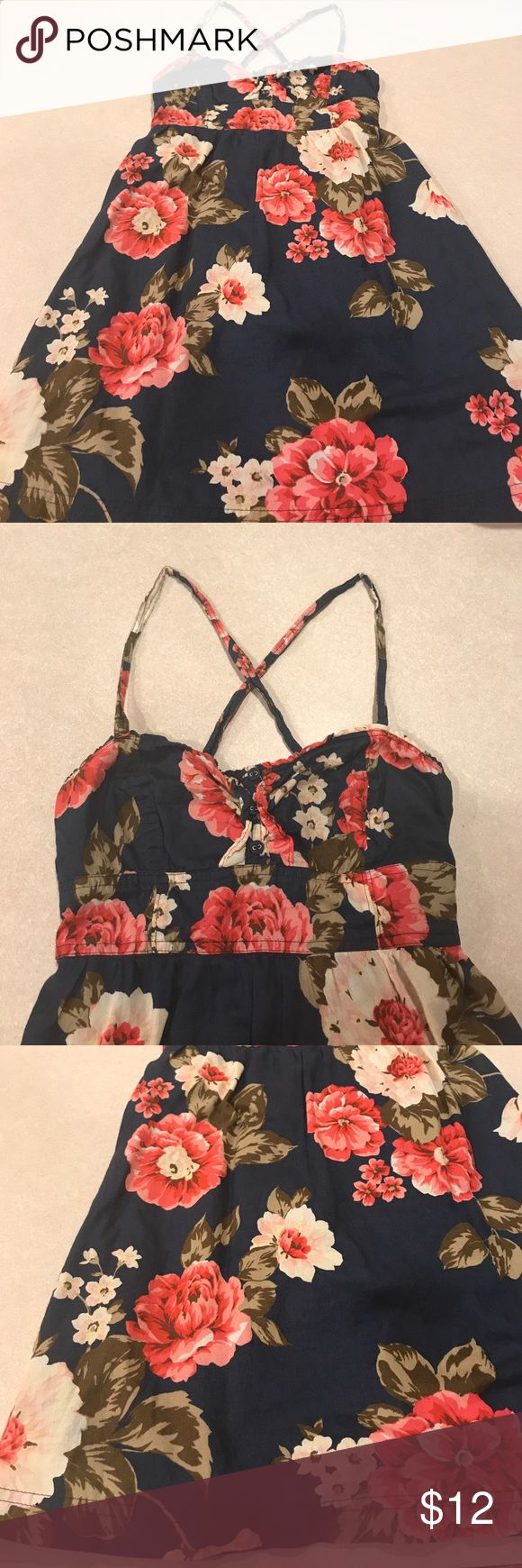 Abercrombie Dress Super cute flower print dress in excellent condition. Has lots of stretch to the back bust area. It's a size xl from Abercrombie kids. It fits me perfect and I'm a size small/  x-small. It's 29 inches from top of strap to bottom and 13 inches from armpit to armpit with lots of stretch. Let me know if you have any questions. Abercombie Kids Dresses