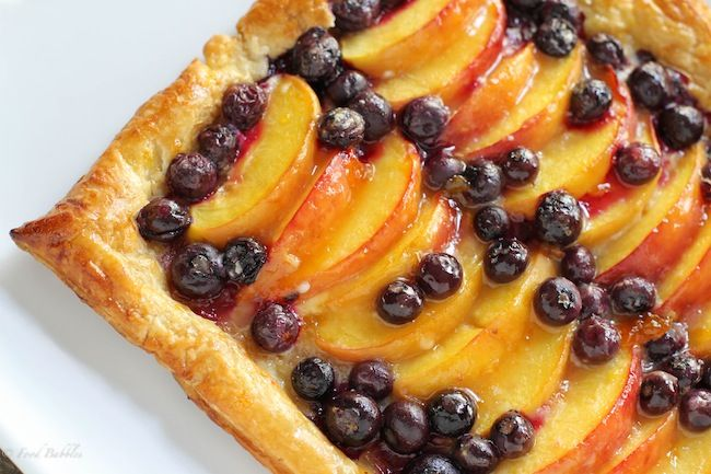 Blueberry Peach Tart - Puff pastry crust filled with fresh, ripe peaches and blueberries for an easy, stunning dessert #peach #blueberry #tart