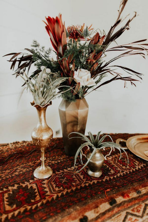From blooms and textiles to vases and candlesticks, including copper in your color palette adds a dose of warmth to the overall atmosphere of your day. | Image by Monique Serra Photography