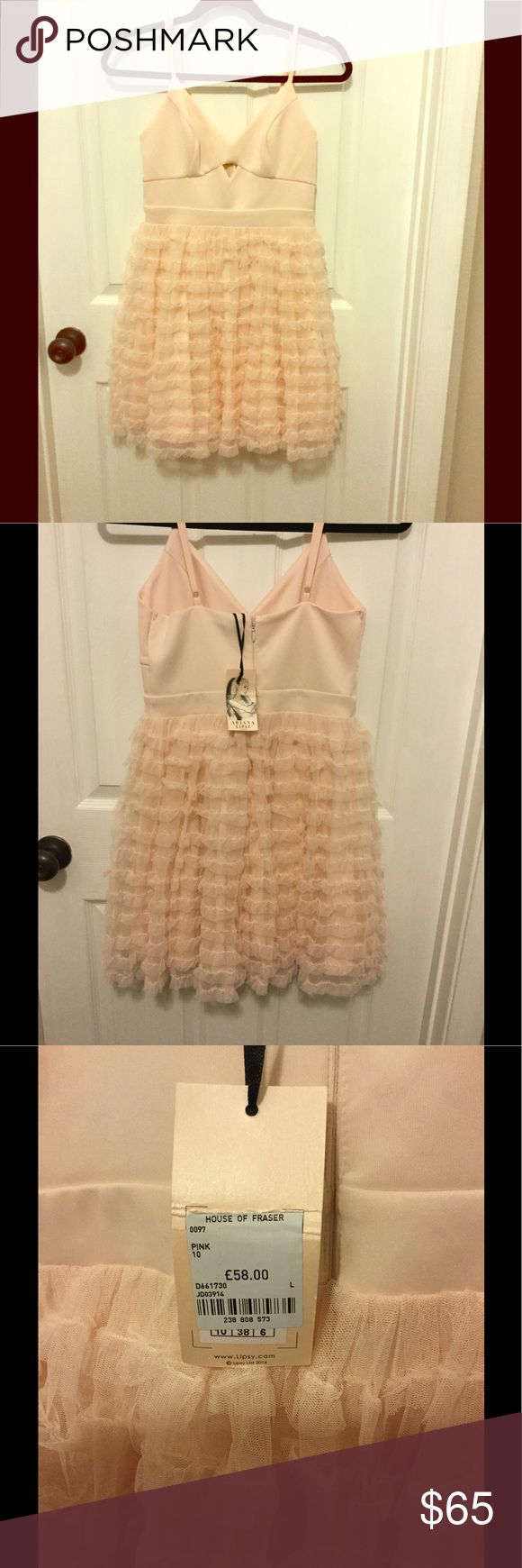 Ariana Grande for Lipsy pink ruffle dress Sweet as sugar pink ruffle dress. Never worn, perfect condition. *Tag shows price in pounds, original price listing has been converted to USD. Ariana Grande Dresses Mini