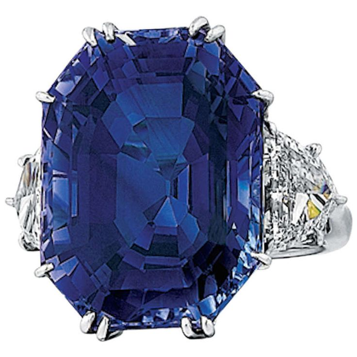 Natural 41.80 Carat Blue Sapphire, Diamond, and Platinum Ring. This platinum ring features a stunning rectangular-cut Ceylon blue sapphire. It is accompanied by an AGL report that verifies the sapphire is not heat treated nor clarity enhanced. The custom mounting also features two shield-cut diamonds that are 2.09 carats total weight, G color, VS2-SI1 clarity. c 2012