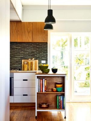 """Felicity Brenchley and her husband saved money on the kitchen cabinetry by using a plywood substrate cut to shape by Cutshop, which uses computer-operated router machines: """"The beauty of this system is that, unlike conventional flat packs, bespoke cabinet sizes and design details can be incorporated at little or no additional cost,"""" says Felicity; they purchased the light shades from Ikea in Australia."""
