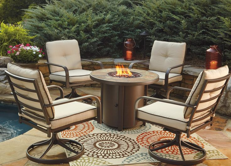 Perfect for outdoor entertaining, yet more comfortable than camping chairs ;-) Predmore 5-Piece Round Fire Pit Table Set by Signature Design by Ashley
