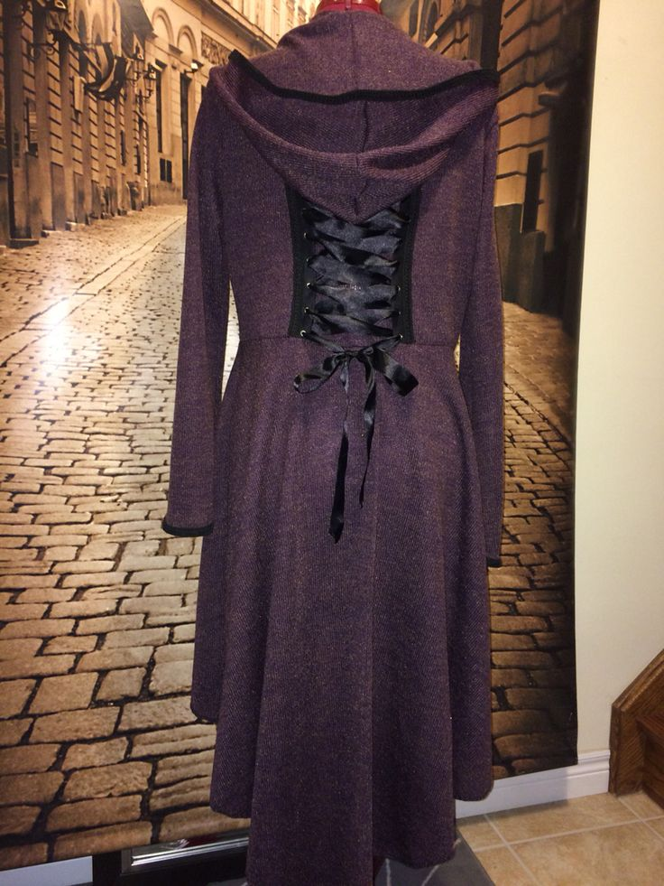Purple faery coat with black trim.