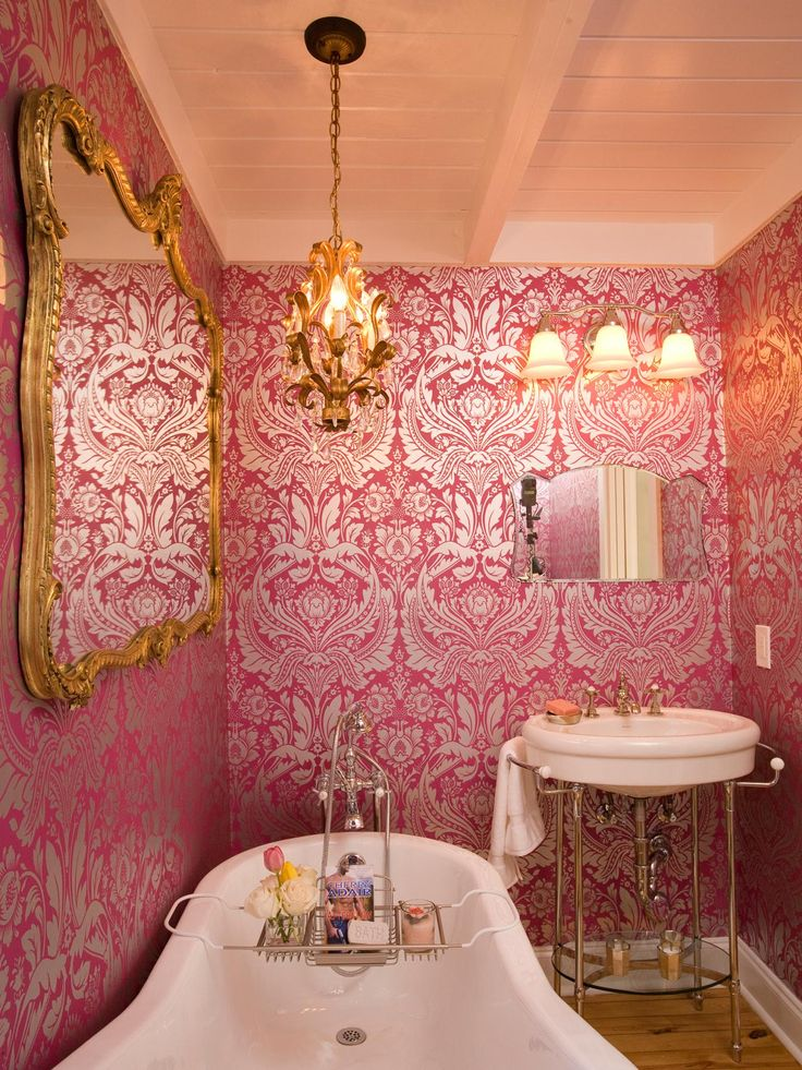 Picture Gallery Website Ornate pink wallpaper a gold leaf chandelier and mirror frame make for a bathroom with