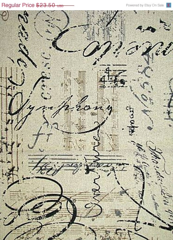 French Musical Script fabric- I covered my chairs in this. Love them.