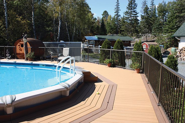 This above ground pool deck was built by Hickory Dickory Decks in Sudbury Ontario. The material is Moistureshield composite decking.
