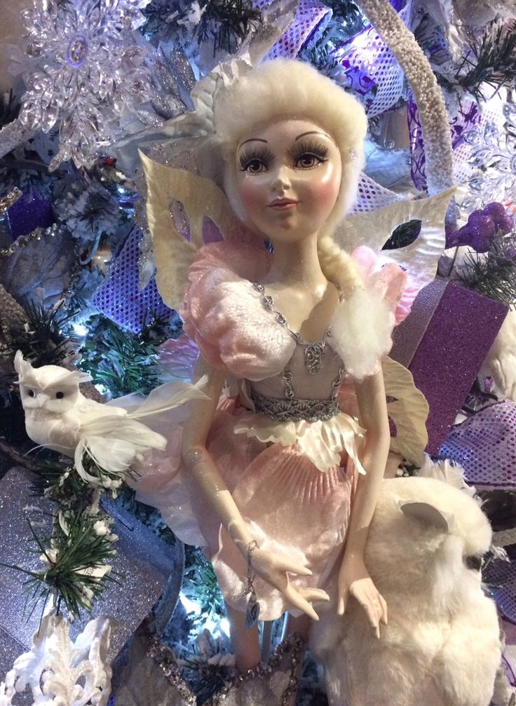 Pink 'Goodwill' fairy in the lilac tree at Christmas Elves.