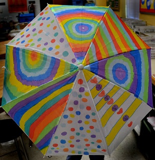 Students decorate umbrellas for auction.  Have to remember for school fundraisers.