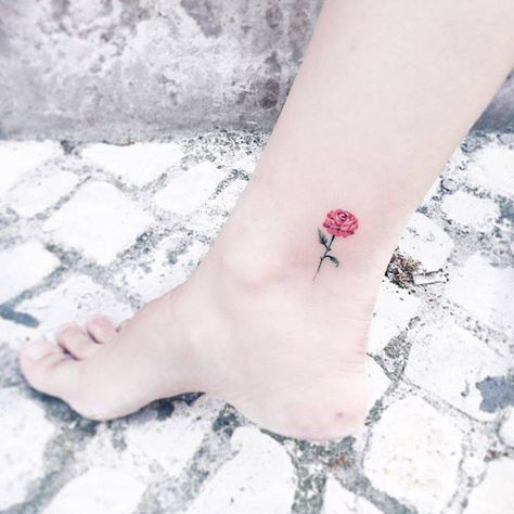 Little red rose tattoo on the ankle.