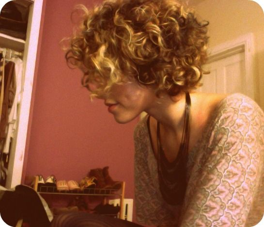 short curly hair. Love the highlights :)